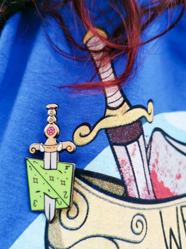D&D enamel pin D4 sword Dungeons and Dragons blog post